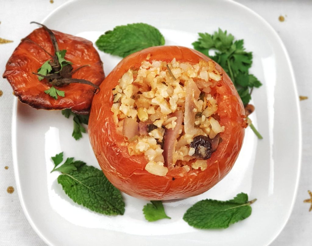 Aerial shot of stuffed tomato with lid off