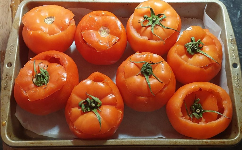 tomatoes with cut lids and flesh scooped out