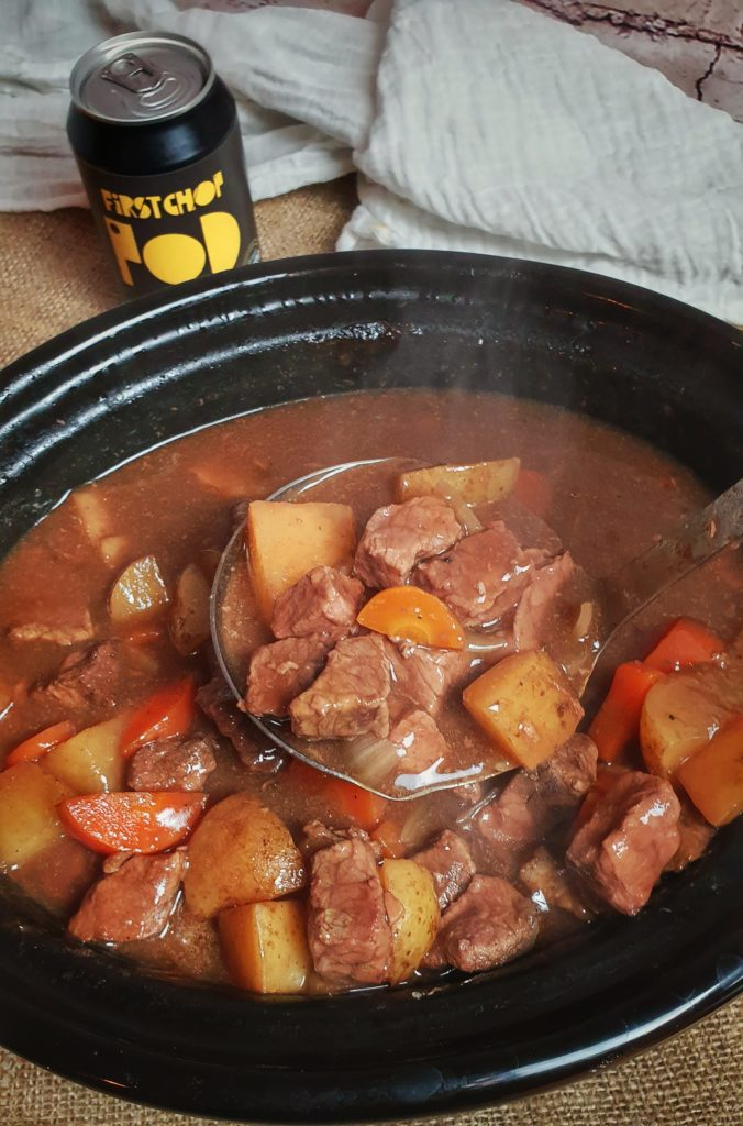 stew in slow cooker with Firstchop stout in background