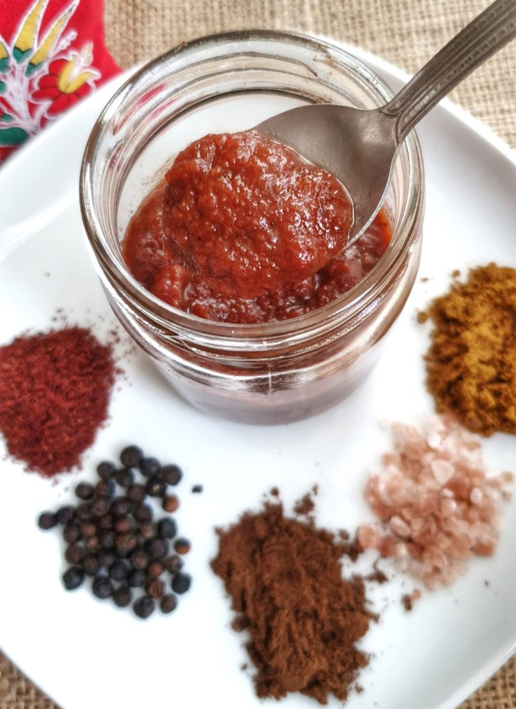 Spoonful of bbq sauce coming out of jar