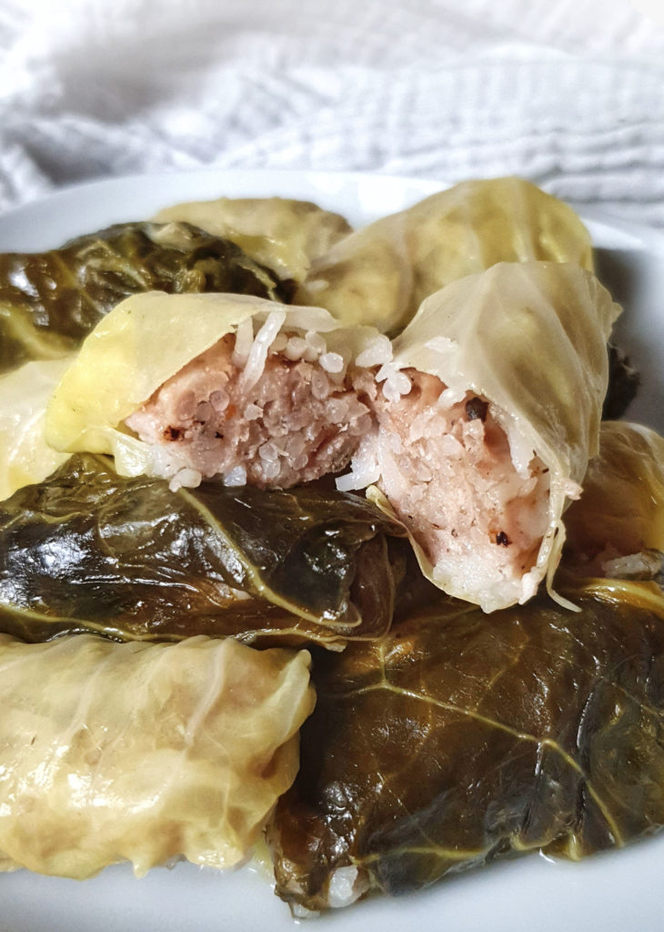 stuffed cabbage cut open on pile of stuffed cabbage
