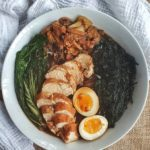 chicken ramen in a bowl with cloth