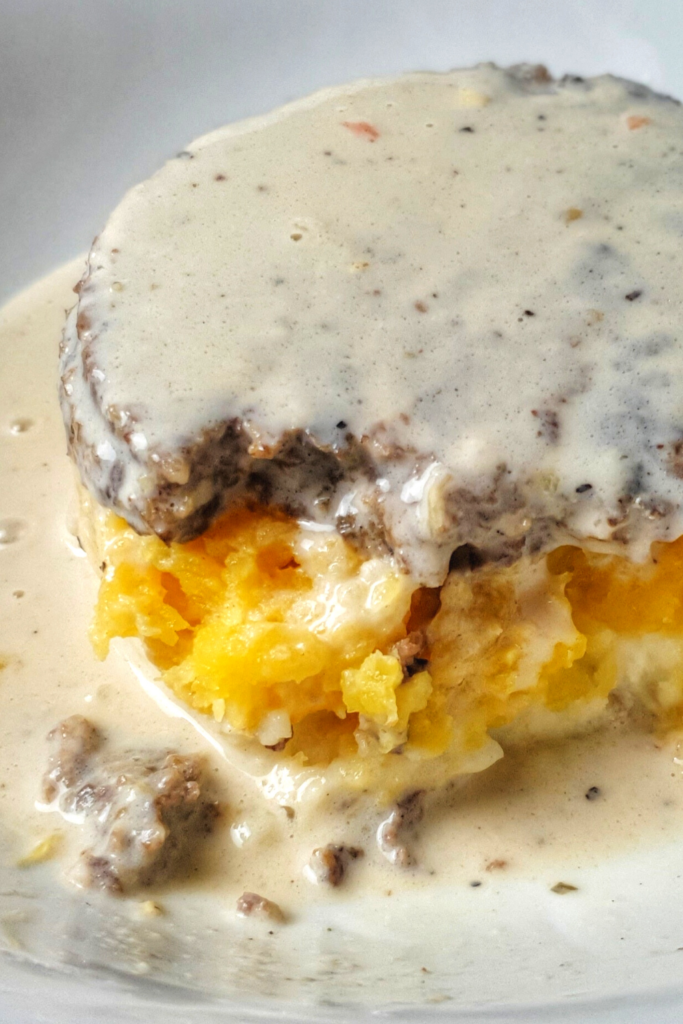 whisky sauce over haggis in bowl