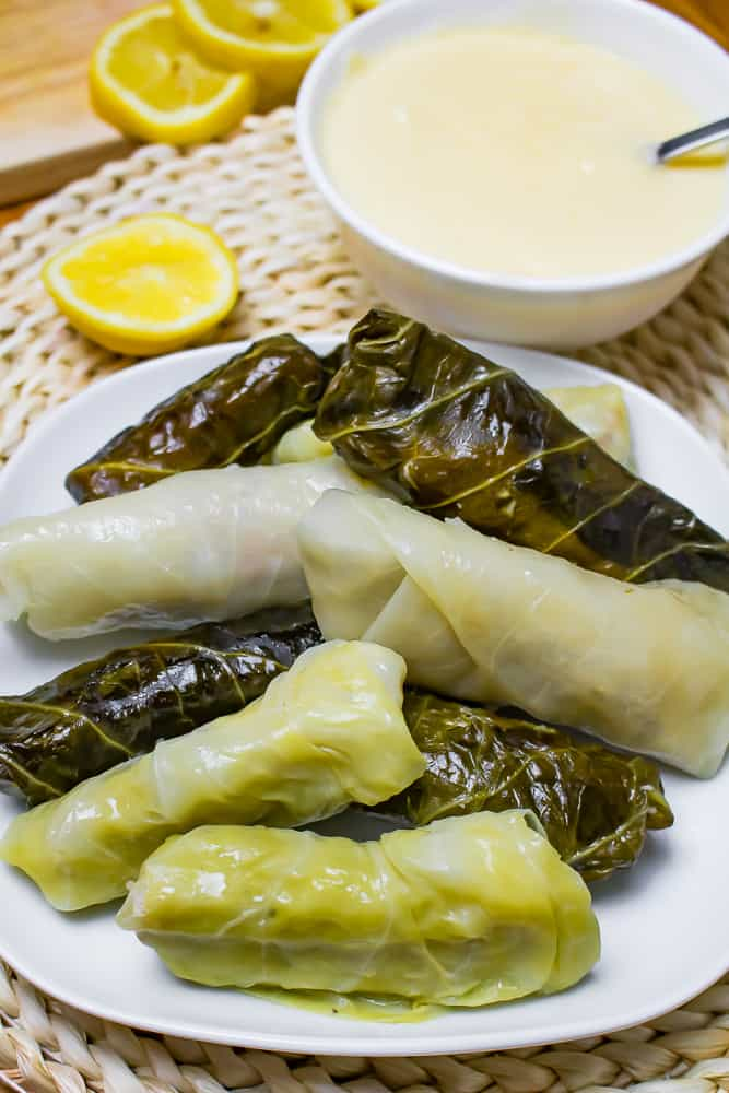 Pile of Greek stuffed cabbage rolls on a white plate